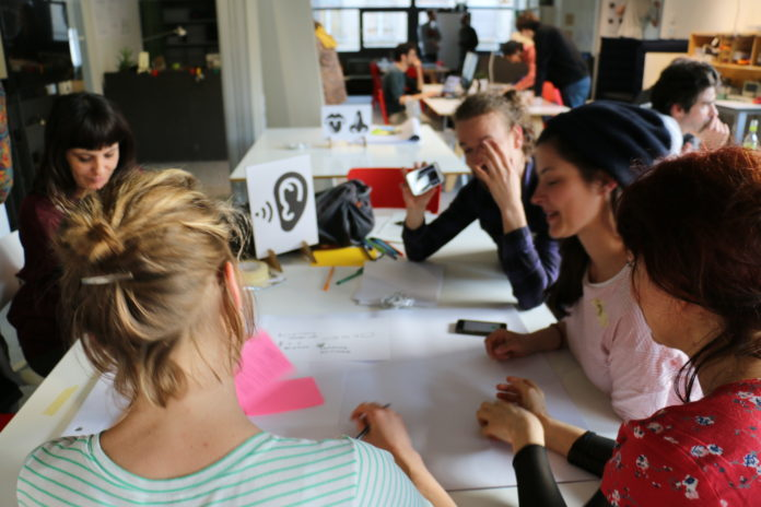 people brainstorming about 'hearing' solutions at a table