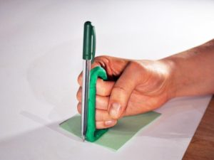 Another prototype which enables to hold a pen while making a fist the fist