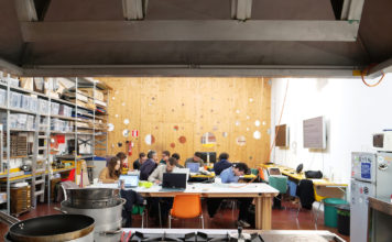 Looking into the OpenDot fablab through the kitchen